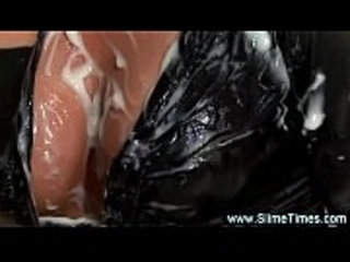 Sexy leather girl plays with cum lubed dildo over her panties